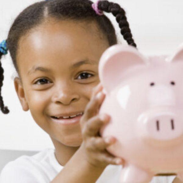 responsible-girl-putting-money-into-piggy-bank-for-future-savings