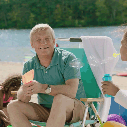 Dr. Rich at a beach with a family
