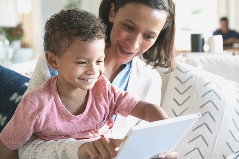 preschooler with parent happy about book