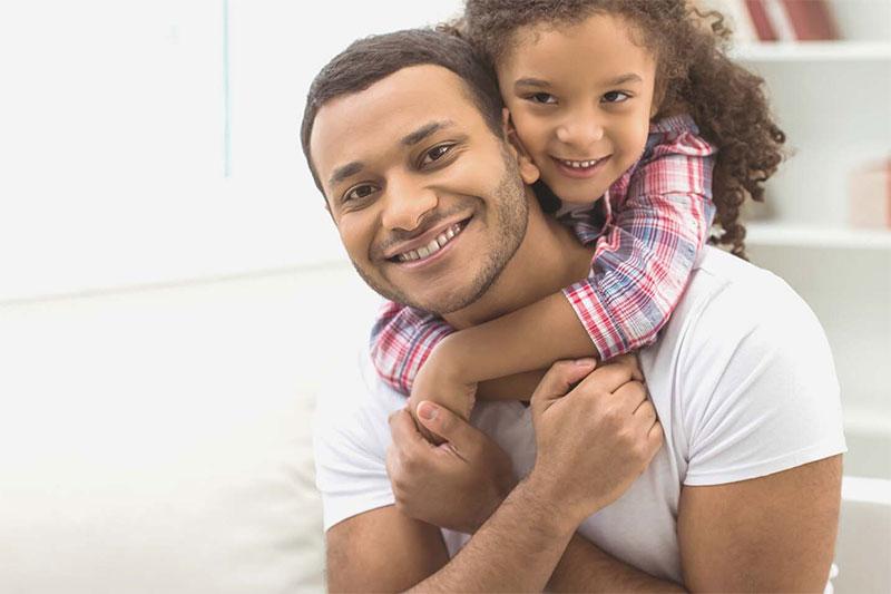 preschooler with parent hugging