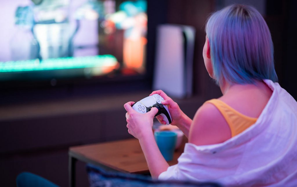 young woman gaming on a console
